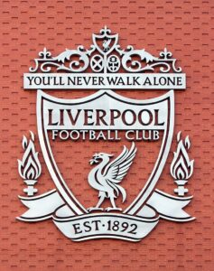 Liverpool FC's Grey Badge on a Red Wall