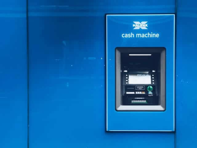 Blue ATM machine in bright setting