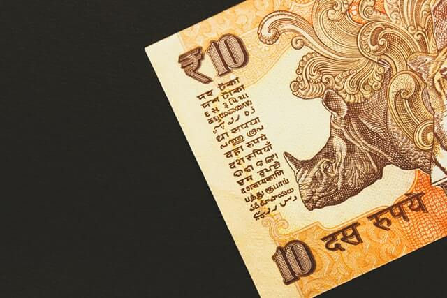 Indian 10 Rupees on a Black Background