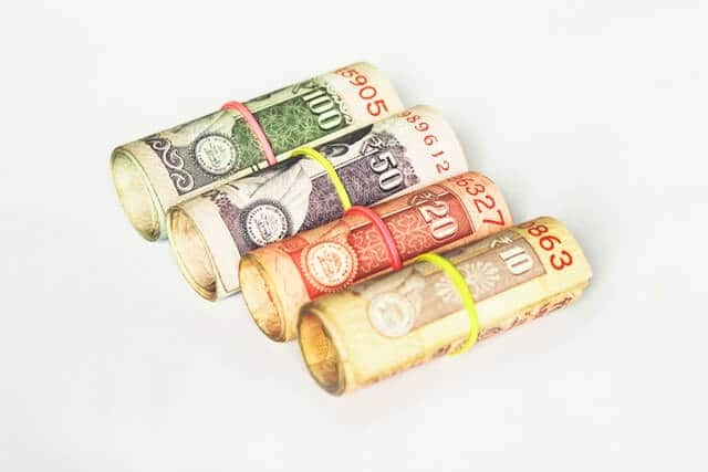 Roll of Rupees on a White Background