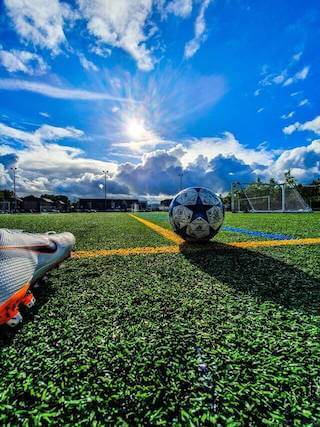 football shoe and ball on grass